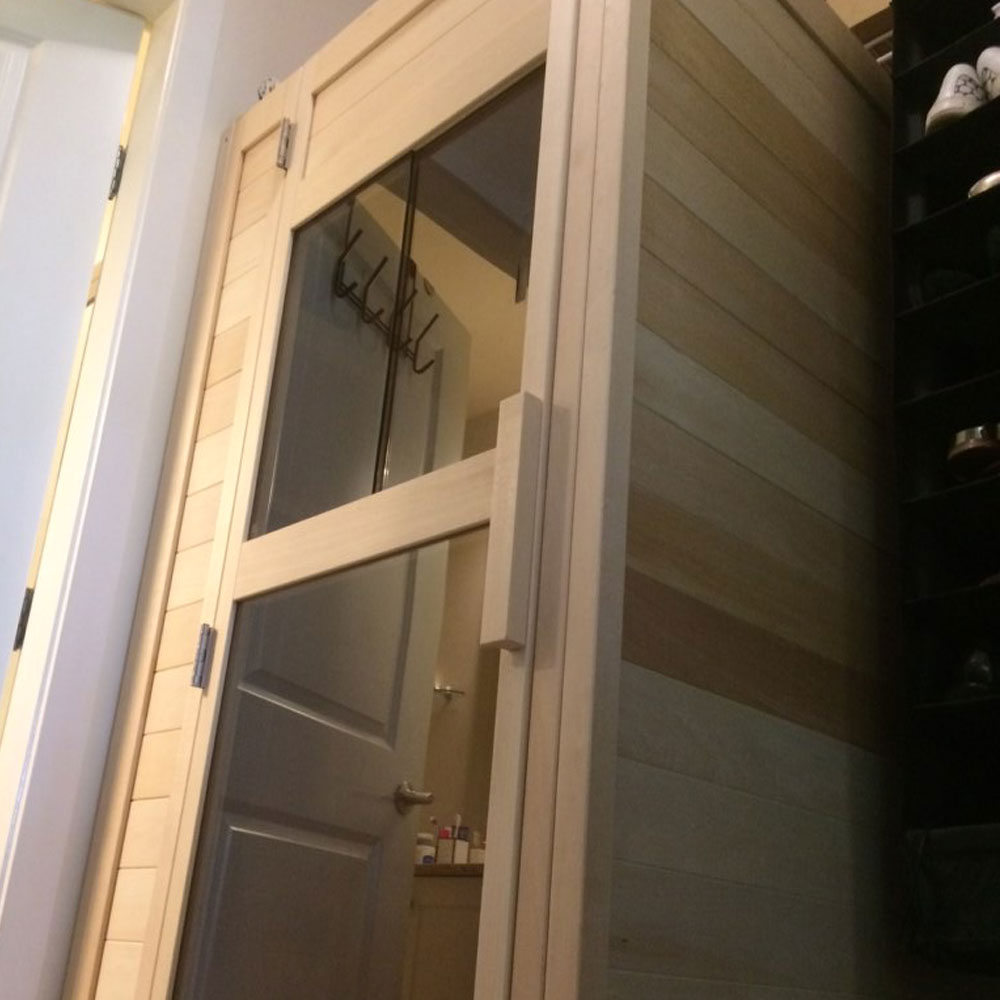 A picture of the door of a custom 1 person infrared sauna. Made in Canadian Basswood.