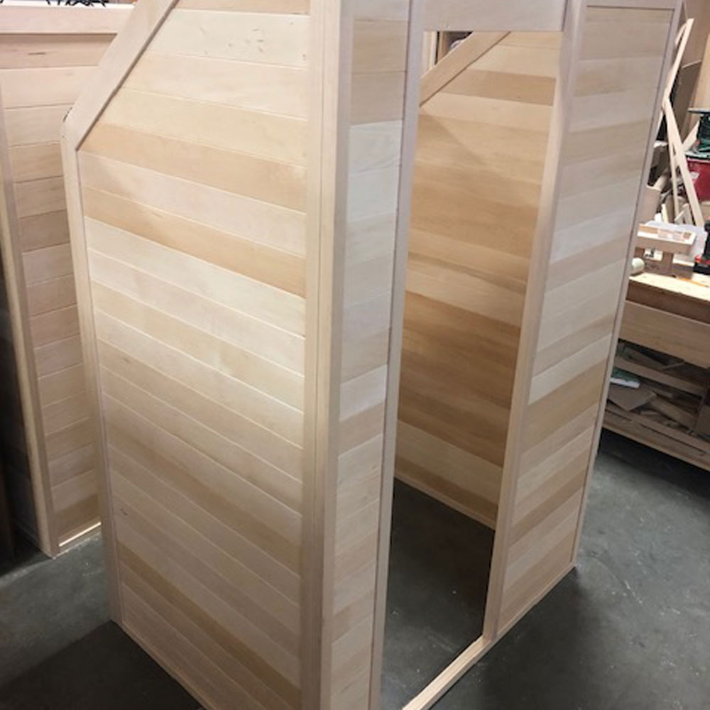 A picture of a custom 1 person infrared sauna. Handcrafted in Canadian Basswood by SaunaRay