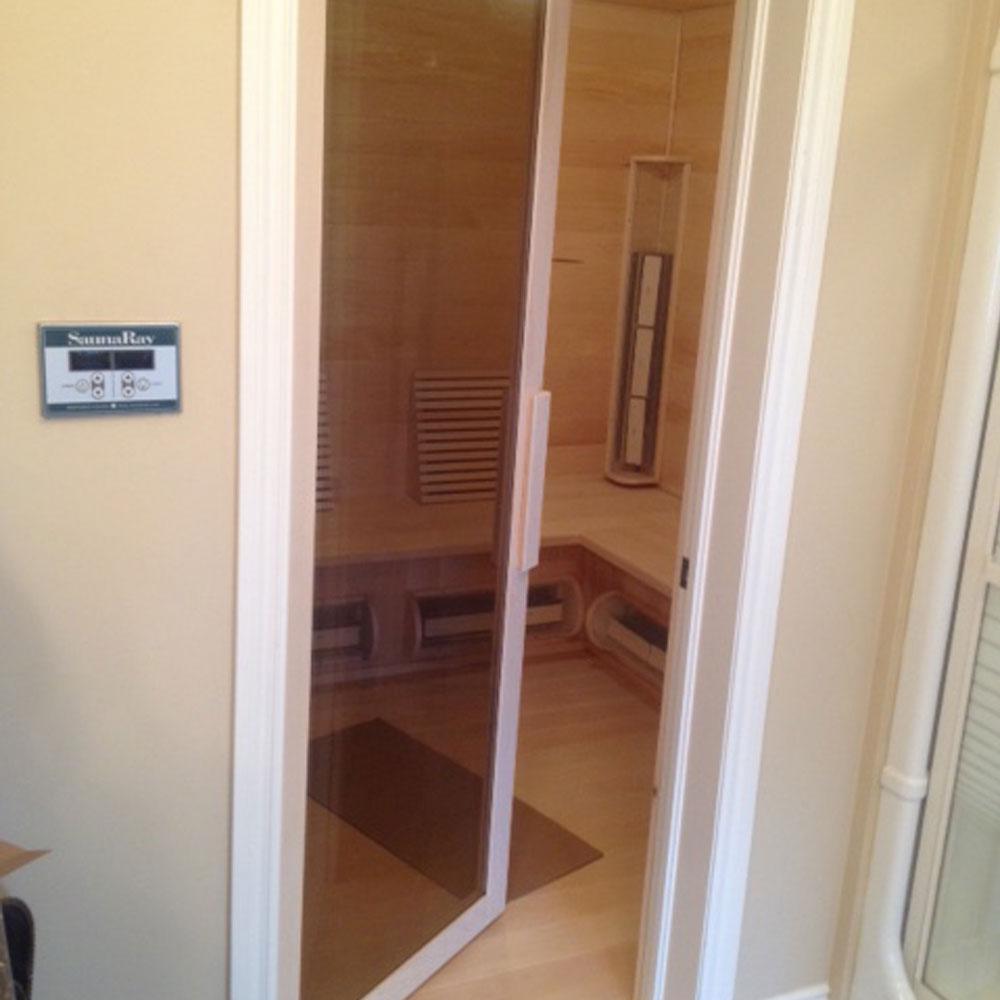 A picture of a custom infrared sauna with a glass door