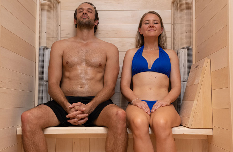 Two people enjoying the SaunaRay far infrared two-person sauna