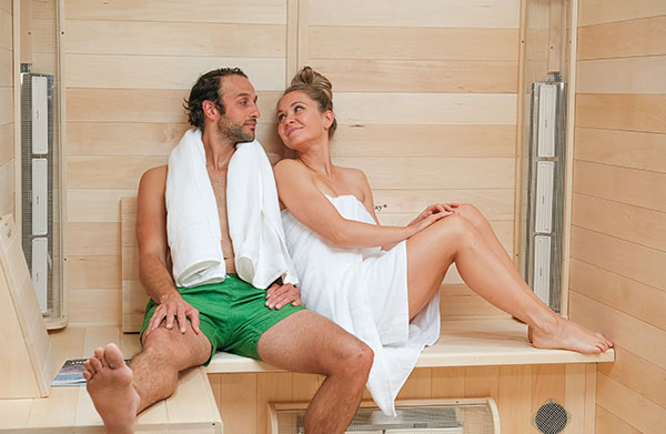 A couple enjoying a relaxing sauna session inside a SaunaRay 4 person infrared sauna
