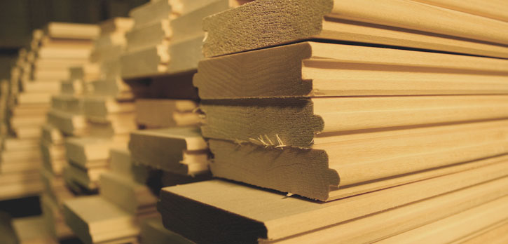 A close-up picture of a stack Canadian Basswood which is used to make SaunaRays infrared sauna